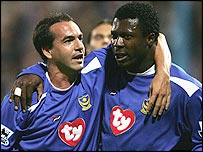 Eyal Berkovic (left) and Yakubu celebrate a Portsmouth goal