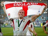 Lawrence Dallaglio celebrates England's historic World Cup triumph in Australia