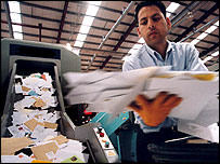 Man sorting mail (Royal Mail)