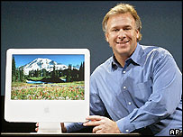 Apple's Philip Schiller shows off the new iMac