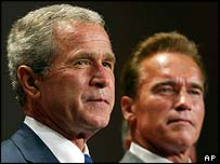 George W Bush at a fundraiser with Arnold Schwarzenegger