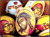 Traditional Easter eggs, depicting Jesus Christ and other religious themes, lie in a basket at an Easter traditions fair in Bucharest, Romania