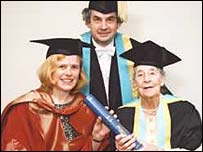 Aeres Evans (right) being presented with her degree