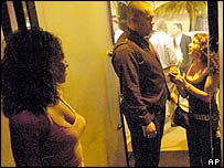 Bouncer talks to woman