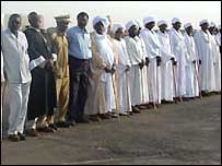 Dignitaries line up at al-Fashir airport in Darfur, Sudan