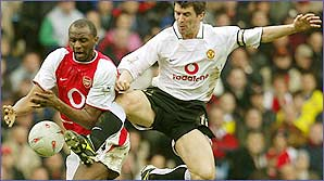 Patrick Vieira and Roy Keane battle for the ball