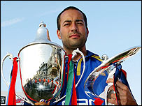 Adam Hollioake with the National League and Twenty20 trophies