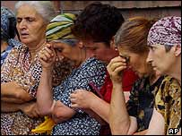 Women wait for news from the school in North Ossetia