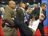 A protester attending the Republican Youth Convention being carried from the floor of Madison Square Garden in New York