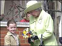 The Queen receiving flowers from five-year-old Abigail Gainher