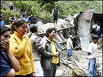 Local people mourn those swept away by the mudslide