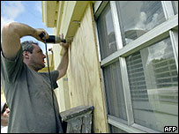 Miami resident use plywood to cover his windows