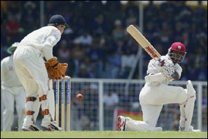 Brian Lara sends another England delivery away for four as Geraint Jones looks on