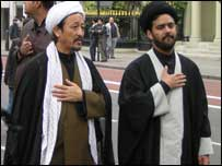 Two traditionally-dressed Shia worshippers in London