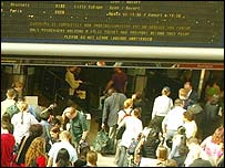 Passengers check train times