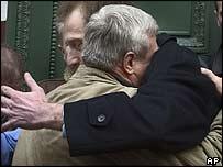 Arjan Erkel hugs intelligence veterans' representative Valentin Velichko