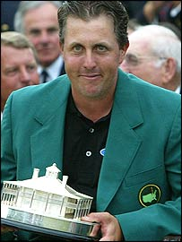 Phil Mickelson smiles in his green jacket
