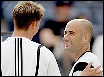 Andre Agassi commiserates with Florian Mayer, who retired hurt
