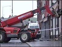 The forklift was smashed into the front of the building