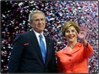 President George W. Bush, left, and first lady Laura wave to delegates at the end of the Republican National Convention in New York's Madison Square Garden