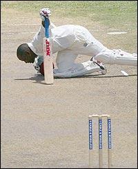 Lara kisses the wicket after beating the world runs record