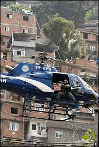 Police helicopter hovers over Rio's Rocinha slum