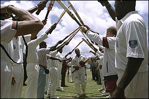The West Indies team show their respect to captain Brian Lara