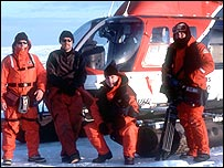 Dr Glenn Boyle, left, with the crew and an IFAW member