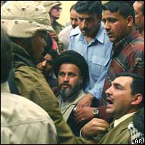 Sheikh Hazem al-Aaraji, centre, and his supporters face a US soldier in a Baghdad hotel