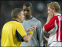 Newcastle's Titus Bramble and PSV Eindhoven's Remco Van Der Schaaf are spoken to by the referee