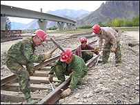 Workers on China's prestige project, a railway linking Tibet to the outside world.