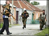 Soldiers take positions at a seized school in Beslan, Russia