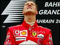 Michael Schumacher looks to the heavens after winning the Bahrain Grand Prix