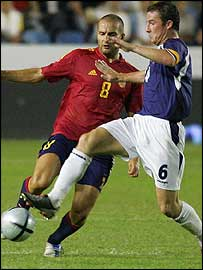 Scotland midfielder Barry Ferguson challenges Spain's Ruben Baraja