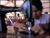 Girls previously working in brothels in Cambodia learn to sew at a safe home