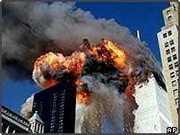 Smoke, flames and debris erupts from the World Trade Center towers, 11 September 2001