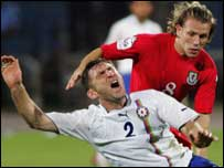Craig Bellamy battles for the ball in Baku