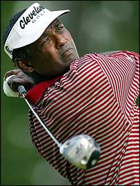 Vijay Singh watches a tee shot during his second round