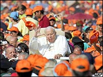 Pope John Paul II waves as he arrives to celebrate an open-air mass in Loreto, Italy. Archive picture