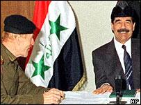 Izzat Ibrahim al-Douri (left) and Saddam Hussein in January 1999