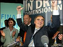 Peter Mueller, CDU prime minister in the state of Saarland, celebrates his victory in the state election