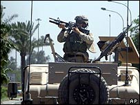 A US army soldier in the turret of a Humvee in Baghdad