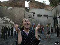 A woman in the ruined school in Beslan