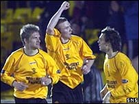 Colin McMenamin (centre) celebrates his equaliser