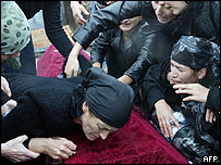 Relatives at the coffin of one of the school siege victims in Beslan
