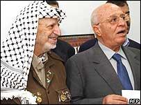 Yasser Arafat (left) and Ahmed Qurei