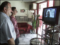 Iraqis watch broadcast of audiotape attributed to Osama Bin Laden