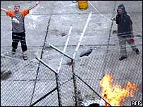 Inmates burning mattresses