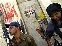 Shia militiamen in the Baghdad suburb of Sadr City