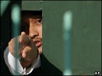 Bali bomber Imam Samudra looks out of his cell at a prison, Tuesday 17 2004